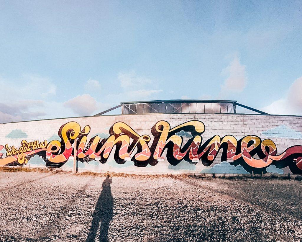 An art mural in Christchurch, New Zealand, saying 'We got the sunshine'