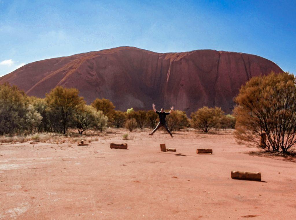 Jumping for joy at seeing Uluru up close