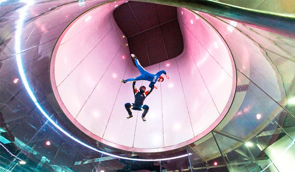2 people indoor skydiving at iFly