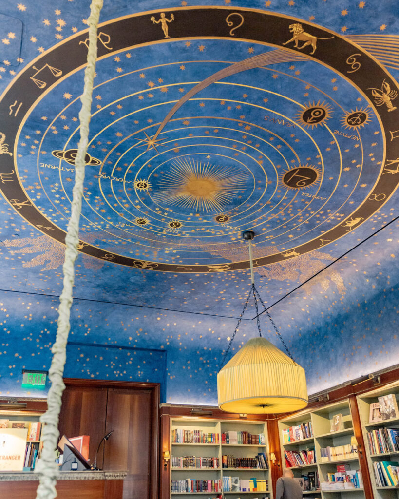 Ceiling painted with astrology signs and night sky motif