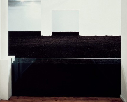 A white room filled with soil