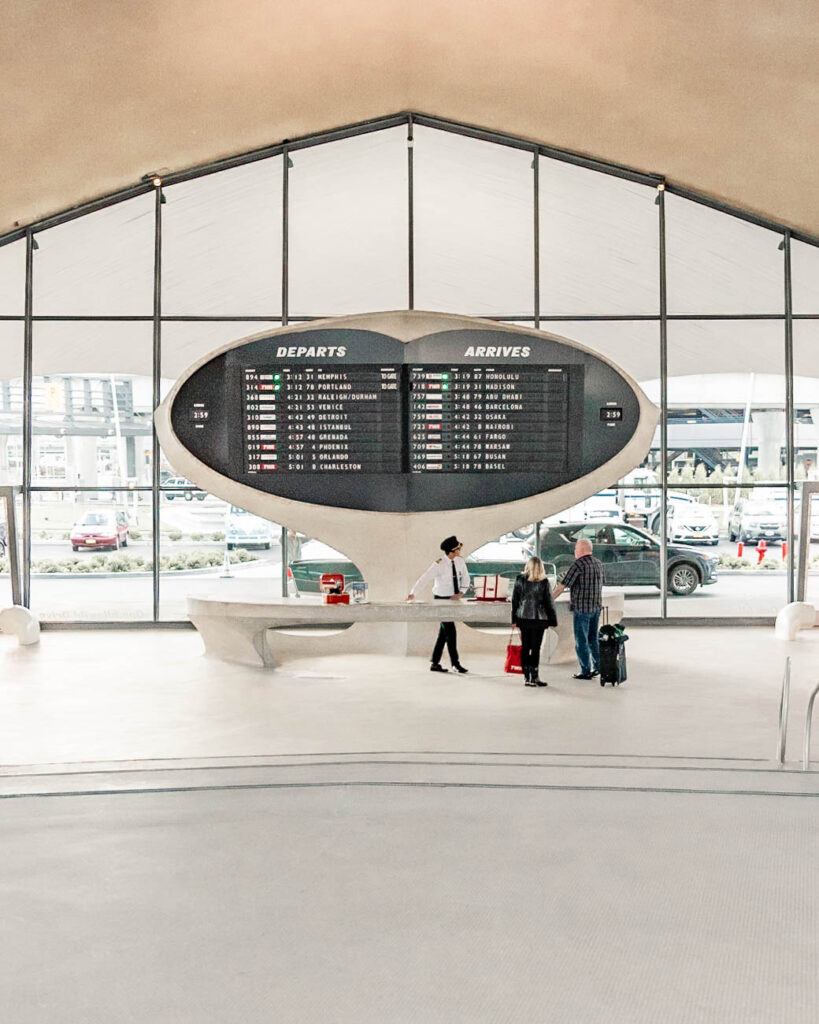 TWA hotel lobby with check in counter that looks like an airport terminal